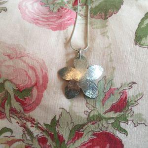 Silver hammer textured flower pendant